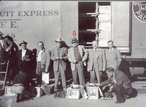 Carlos Bennen (arrow) unloads produce in Nogales